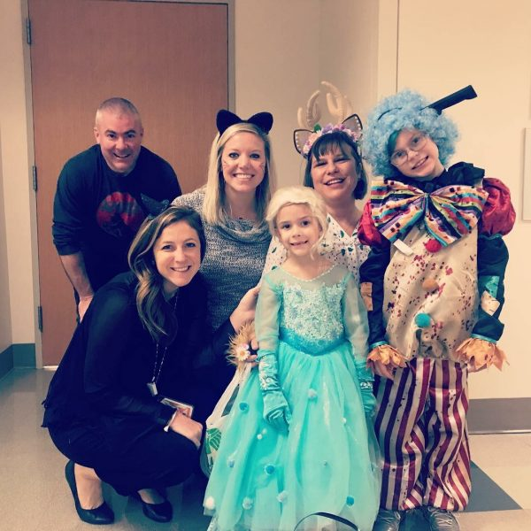Kennedy family trick or treating around the hospital with friends