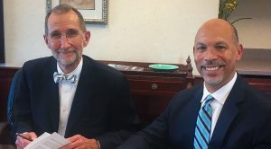 Dr. William Roper (left) and Gene Woods (right).