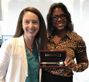 Dr Kibbe presents a UNC Children's Hospital honorary key  to Dr. Hayes-Jordan