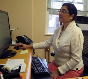 Dr. Pandya looks over her research.