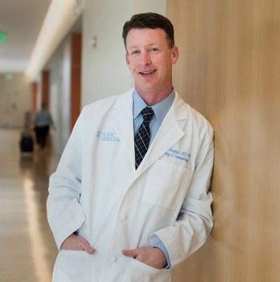 Dr. Scott Commins