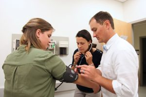 Patrick O'Shea instructs MedServe Fellows Allison Draper and Laura Byrd during the MedServe Training Institute/ Photo by Lane Deacon