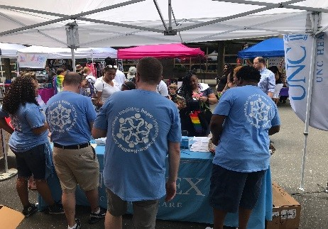 Activity at the UNC REX Healthcare Booth at OUT!Raleigh