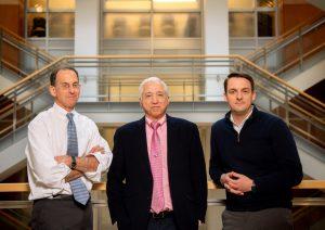 From left: David Margolis, MD, J. Victor Garcia, PhD, and Richard Dunham, PhD (credit: Jon Gardiner, UNC-Chapel Hill)