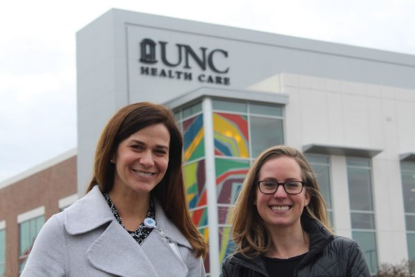 Claire West, MD, and Julia Tompkins, MSW, LCSW, outside the brand-new UNC Medicine Clinic at Panther Creek.