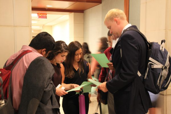 A group of students participates in a campus scavenger hunt