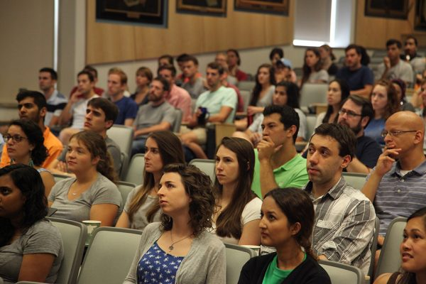 Members of the Class of 2020 listen to a presentation as a part of their orientation week